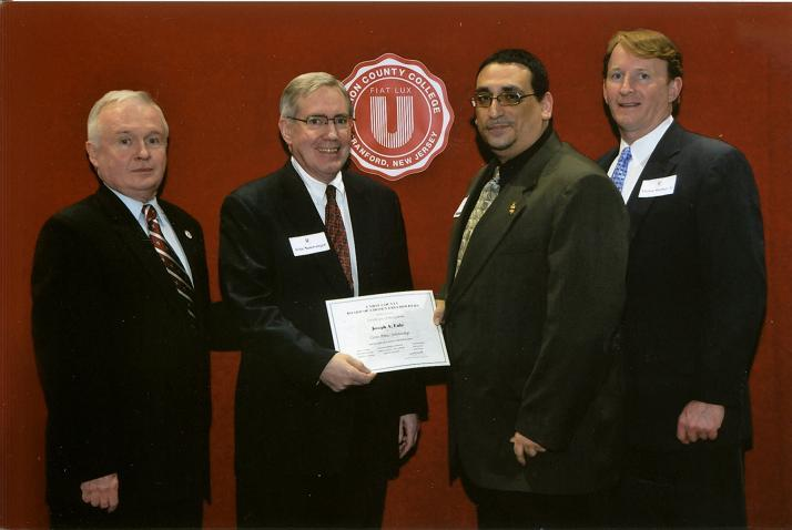 The Scholarship certificate was resented by (left to right) Dr. Thomas H. Brown, resident of Union County College; John Neiswanger, Board of Governors of UCC and member of Cento Amici; Joseph Eulo, Cento Amici Scholarship recipient; and Thomas J. Sharkey Jr., Chair of the Union County College Foundation